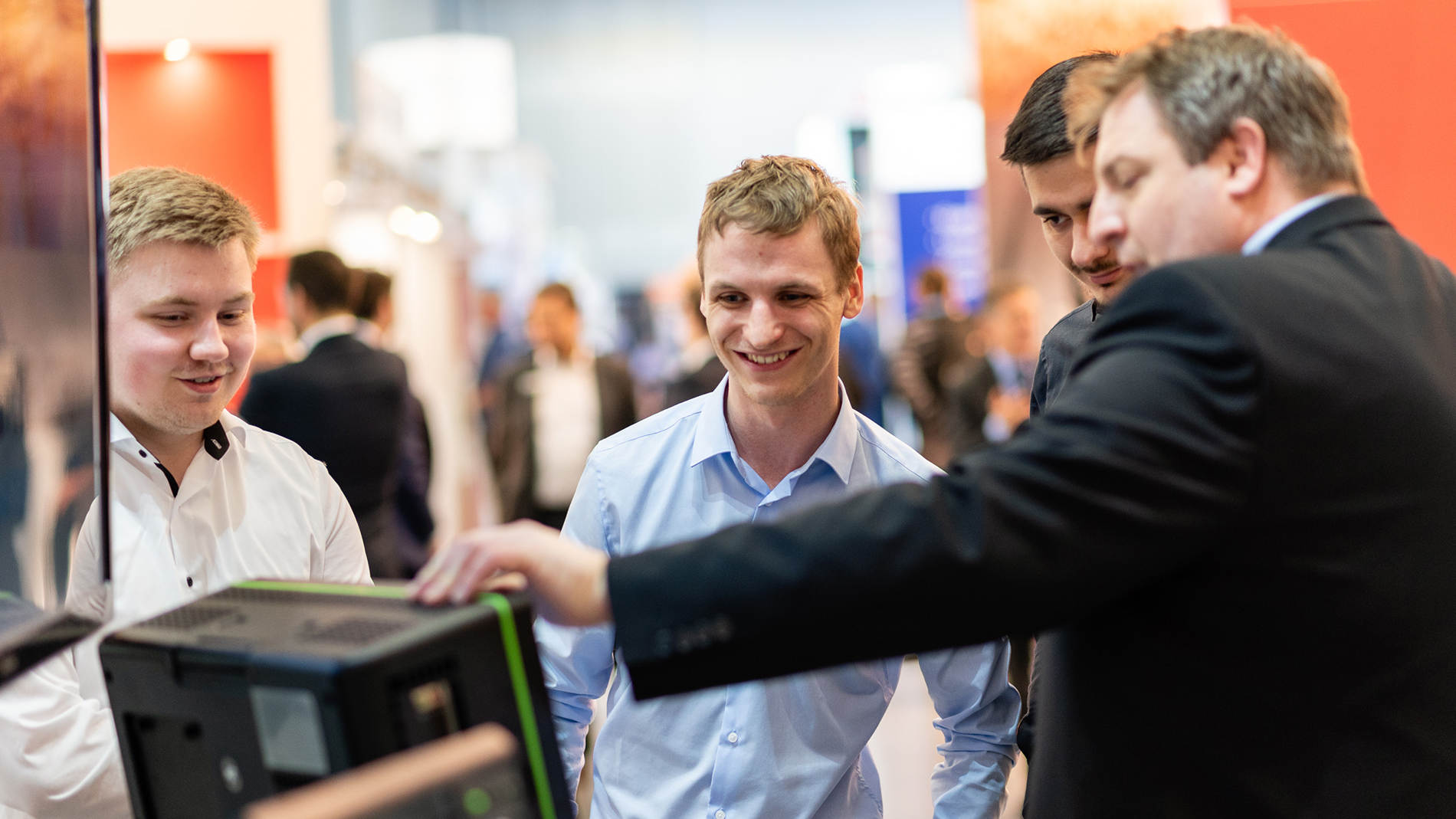 Young students at the booth of Teledyne LeCroy GmbH